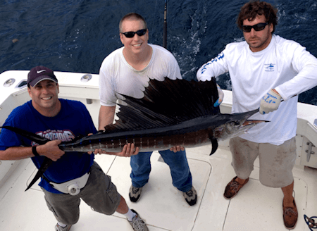 Guys with Outer Banks sailfish on offshore fishing charter.