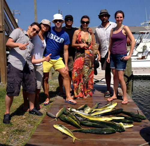 Vacationing group with a nice pile of mahi mahi on the Outer Banks.